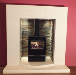 Chateau limestone fireplace with lights