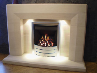 Optica Limestone fireplace with lights