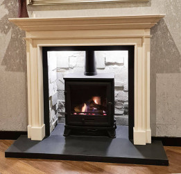 Blenheim limestone fireplace with chamber