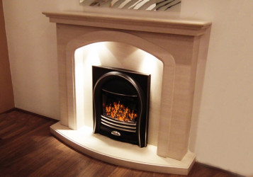 Mirage limestone fireplace with lights