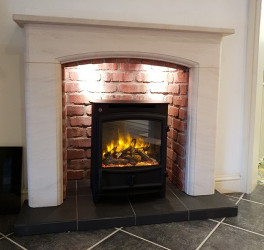 Sissari limestone fireplace with brick effect chamber